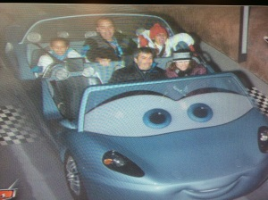 (Left to right) Ally, Dad, and Me in the Cars Ride.