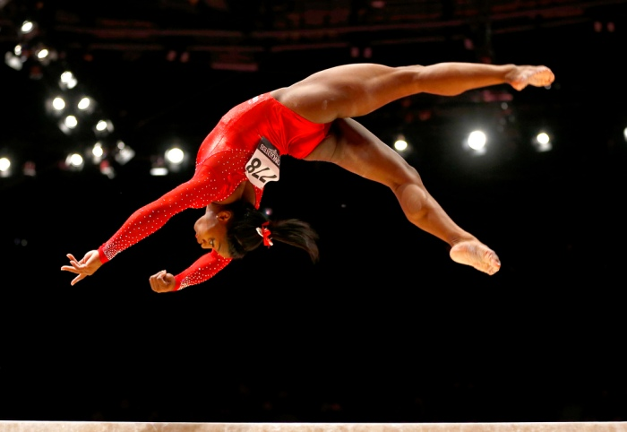 Simone Biles of the U.S. performs on the balance beam during the women's all-around final competition at the World Artistic Gymnastics championships at the SSE Hydro Arena in Glasgow, Scotland, Thursday, Oct. 29, 2015. (AP Photo/Matthias Schrader)